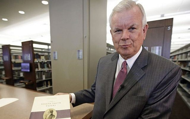 The Church of Jesus Christ of Latter-day Saints historian Steven E. Snow displays the third volume of the Joseph Smith Papers, which includes the printer's manuscript of the Book of Mormon, Salt Lake City, Utah, August 4, 2015. (AP/Rick Bowmer)