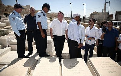 MKs tour the Mount of Olives cemetery with police on August 9, 2015 (Courtesy)
