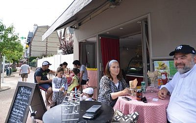 Nadia and Shimon Wilhelm at a kosher restaurant in the French resort town of Deauville, July 24, 2015. (Cnaan Liphshiz/JTA)