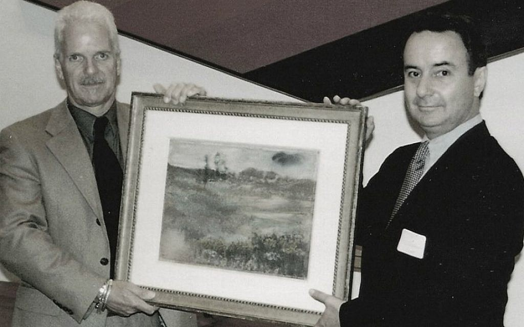 Brothers Nick and Simon Goodman holding a reclaimed Degas landscape, Chicago, 1998. (Courtesy of Goodman family)