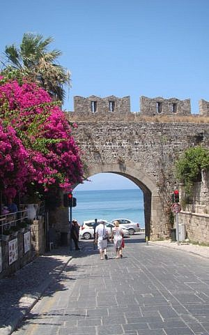 Tourists walking through the old city walls of Rhodes near the Square of Jewish Martyrs. (Gavin Rabinowitz/JTA)