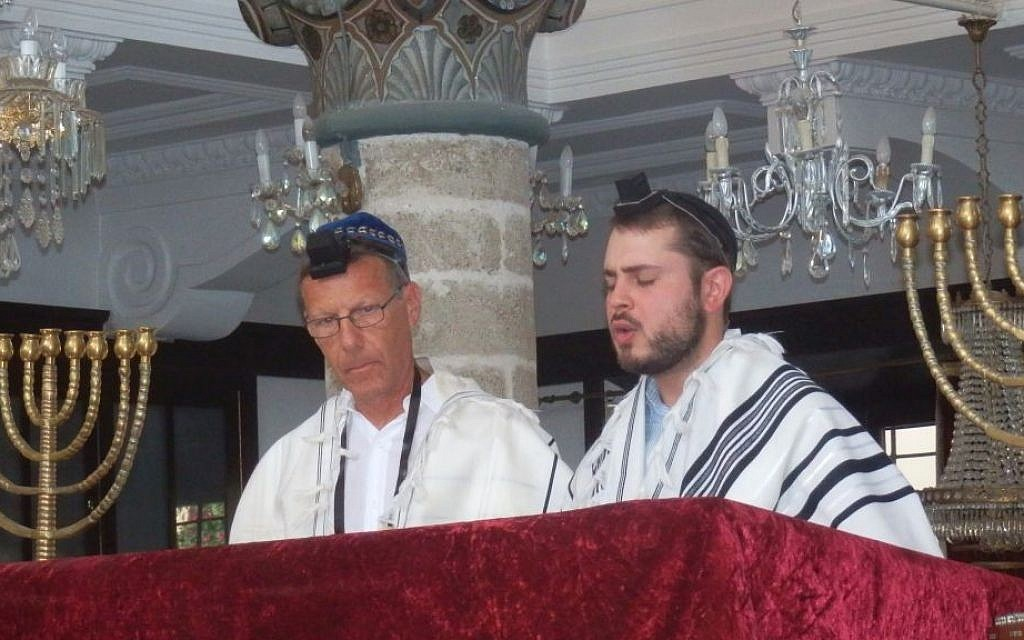 Giuseppe Giannotti, left, celebrating his bar mitzvah at the Kahal Shalom Synagogue in Rhodes at age 60 in 2014. (Courtesy of Giuseppe Giannotti/JTA)