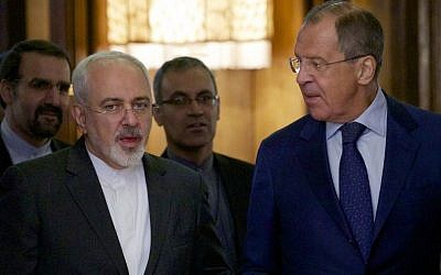 Iranian Foreign Minister Mohammad Javad Zarif, left, chats with Russian Foreign Minister Sergey Lavrov upon being welcomed by Lavrov for their meeting in Moscow, Russia, on August 17, 2015. (AP/Ivan Sekretarev)