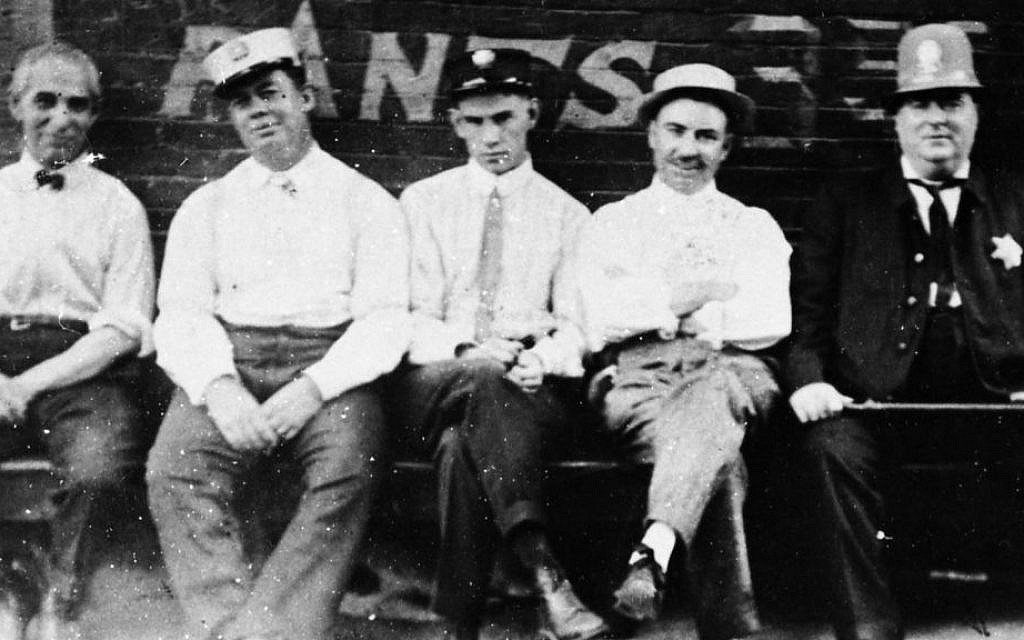 Residents of Memphis's historic Pinch neighborhood, early 1900s, from left to right: Solomon Peiser, Tailor, Mr. Klink, Milkman, Postman, Italian Restaurant Owner, Mr. Nearn, Irish Policeman.  (c 2015 Center for Southern Folklore Archives. From The Peiser Family Collection)