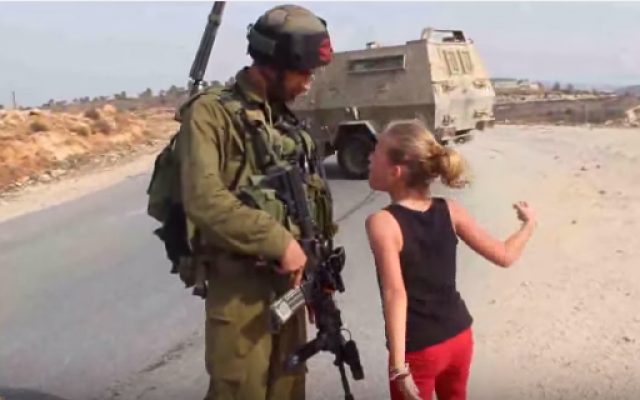 A'hd Tamimi, sister of the boy whose attempted arrest by an Israeli soldier led to a West Bank scuffle on August 28, faces up to a soldier in 2012 (Screen capture via YouTube)