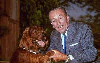 "In this Dec. 23, 1965, file photo, Walt Disney poses for a photo with an Irish setter. Talking to TV critics Sunday, Aug. 2, 2015, about PBS' ""American Experience"" September documentary on Disney, composer Richard Sherman (Disney's ""Mary Poppins,"" ""The Jungle Book"") dismissed lingering criticism of Disney. Disney was a complex figure, both celebrated and condemned, but allegations that he was a rabid anti-Semite are unproven, Disney experts said. (AP Photo, File)"