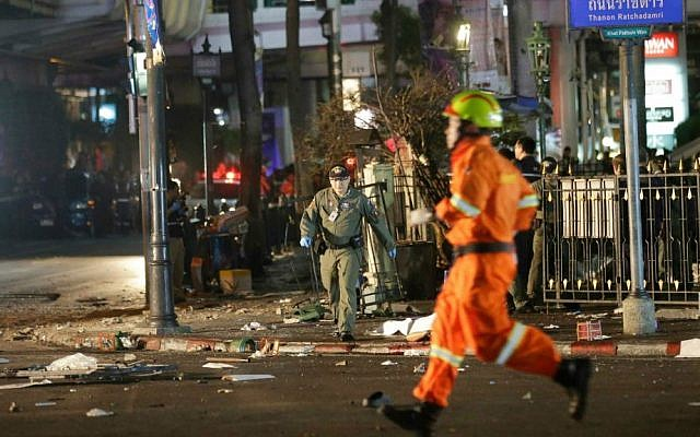 Emergency personnel work at the scene after an explosion in central Bangkok, Monday, Aug. 17, 2015. (AP Photo/Sackchai Lalit)