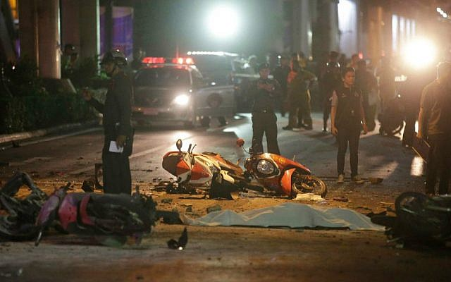 Motorcycles and debris lies on the pavement after an explosion in central Bangkok, Monday, Aug. 17, 2015. (AP Photo/Sackchai Lalit)
