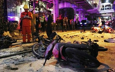 Motorcycles are strewn about after an explosion in Bangkok, Monday, Aug. 17, 2015. (AP Photo/Jerry Harmer)