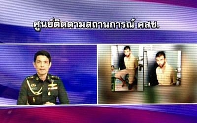 Image taken from video broadcast by the National Council for Peace and Order (NCPO) as NCPO spokesman Col. Winthai Suvaree, left, discusses the arrest of a man, right, in Bangkok, 12 days after a bombing at Erawan Shrine, In this Saturday, Aug. 29, 2015. (National Council for Peace and Order via AP)
