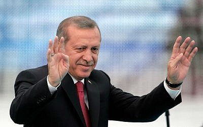 In this May 30, 2015 photo, Turkey's President Recep Tayyip Erdogan waves to the crowds in Istanbul, Turkey, during a rally to commemorate the anniversary of city's conquest by the Ottoman Turks. (AP Photo/Lefteris Pitarakis, File)