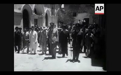 Members of the United Nations Special Committee on Palestine tour the Old City of Jerusalem in 1947 (Screenshot of newsreel footage from YouTube)
