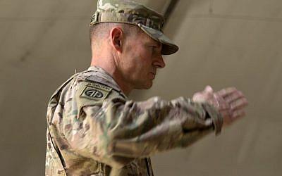 US Army Brig. Gen. Wilson Shoffner salutes at Kabul International Airport base in Kabul, Afghanistan, on July 22, 2015. (AP/Massoud Hossaini, File)