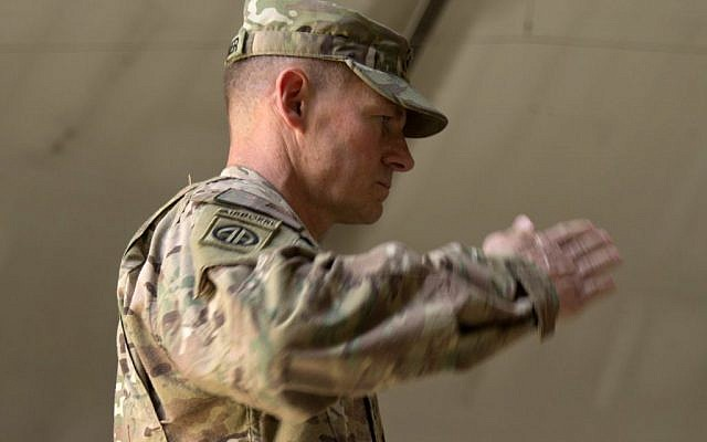 US Army Brig. Gen. Wilson Shoffner salutes at Kabul International Airport base in Kabul, Afghanistan, on July 22, 2015. (AP/Massoud Hossaini, File)