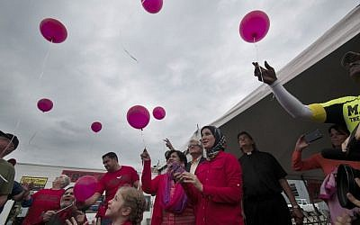 Balloons are released during a rally for Amir Hekmati in Bay City, Mich., on Saturday, Aug. 29, 2015 to mark the four-year anniversary of Iran's refusal to free the former US Marine from prison. (Nicole Hester/The Bay City Times via AP)