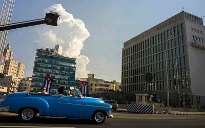 Tourists ride on a vintage American car in front of the US embassy in Havana, Cuba, Thursday, Aug. 13, 2015. (AP Photo/Ramon Espinosa)