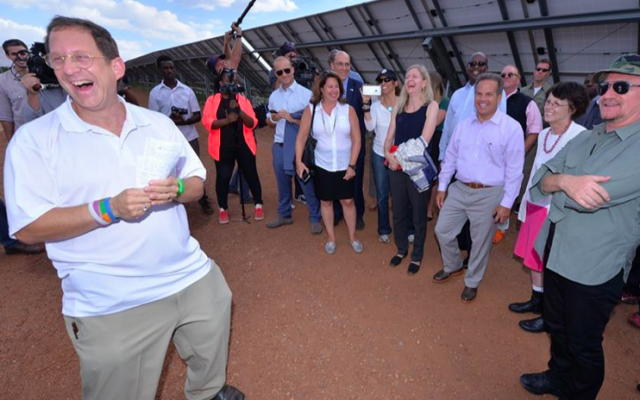 A pleased Yosef Abramowitz greets Bono at a Rwandan solar field this week (Courtesy Yosef Abramowitz)