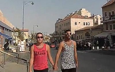 Two men holding hands are verbally assaulted in Jerusalem, in a video produced by Ynet (Ynet screen capture)