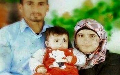Saad and Riham Dawabsha, with baby Ali. All three died when the Dawabsha home in the West Bank village of Duma was firebombed, by suspected Jewish extremists, on July 31, 2015 (Channel 2 screenshot)