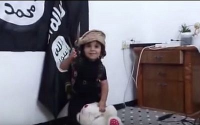 Illustrative: A child decapitates a teddy bear in an Islamic State-style video (YouTube screen grab)