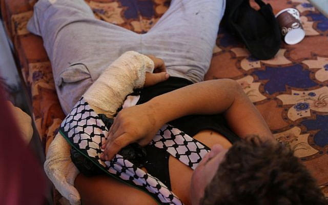 A 12-year-old Palestinians boy lies down in his Nabi Saleh home after other Palestinians fought an IDF soldier from arresting him Eric Cortellessa/Times of Israel)