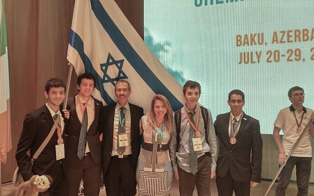 Members of the team representing Israel in the International Chemistry Olympiad in Baku, Azerbaijan July 30 2015. (R to L) Itai Zvieli, Ran Solan, Dr. Izena Nigel-Ettinger, Professor Zeev Gross, Roni Aaronson, and Nadav Ginnosar (Courtesy)