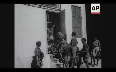 British soldiers search a house in Tel Aviv for terrorists during a four-day curfew in 1946 (Screenshot of newsreel footage from YouTube)
