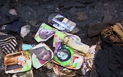 Family photos lie in the remains of the Dawabsha home in the West Bank village of Duma, after it was firebombed by suspected Jewish extremists on July 31, 2015. The family's 18-month-old baby was killed in the attack and his father died of his injuries eight days later, on August 8, 2015. (YouTube screen capture)
