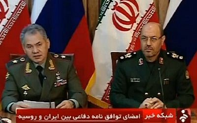 Iranian Defense Minister Hassan Dehghan, right, and his Russian counterpart Sergei Shoigu attend a press conference in Tehran in January 2015. (screen capture: AFP)