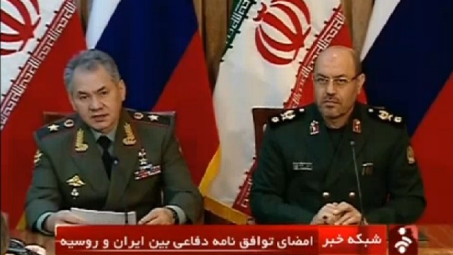 Iranian Defense Minister Hassan Dehqan at a press conference with his Russian counterpart Sergei Shoygu in January 2015. (Screen capture AFP)