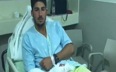 IDF Lieutenant Daniel Elbaz, who was injured along with two other soldiers in an attack on his patrol in the West Bank on Thursday, August 6, 2015. (screen capture: Channel 2)