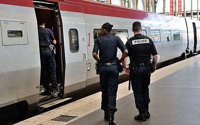 Member of Belgian and French police stay next to a Thalys train at the Brussels Midi - Zuid train station, on Saturday, August 22, 2015. Security has become more visible after an attack on Friday of a Thalys train traveling from Amsterdam to Paris. (Francois Walschaerts/AP)