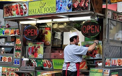 Illustrative image of a Halal food stand in New York. ( Halal Store via ChameleonsEye / Shutterstock.com