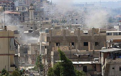 Smoke billows in the Ain al-Helweh Palestinian refugee camp near Lebanon's southern port city of Sidon on August 23, 2015. (Mahmoud Zayyat/ AFP)