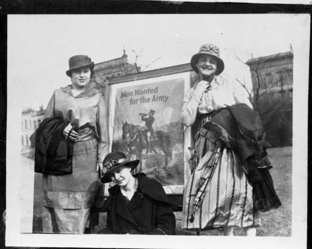 Early 1900s female residents of Memphis neighborhood called the Pinch stand next to a sign stating, 'Men Wanted.' (c 2015 Center for Southern Folklore Archives. From The Peiser Family Collection)