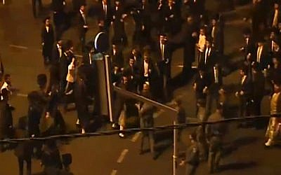 Ultra-Orthodox men clash with police in Jerusalem during an August 14, 2015, protest against the opening of the Yes Planet cinema complex on Shabbat. (screen capture: Channel 2)
