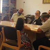 Convert 'Katya' and her daughter sit before the independent Giyur Kahalacha conversion court, led by Rabbi Nahum Rabinovitch (center) on August 10, 2015. (courtesy/file)