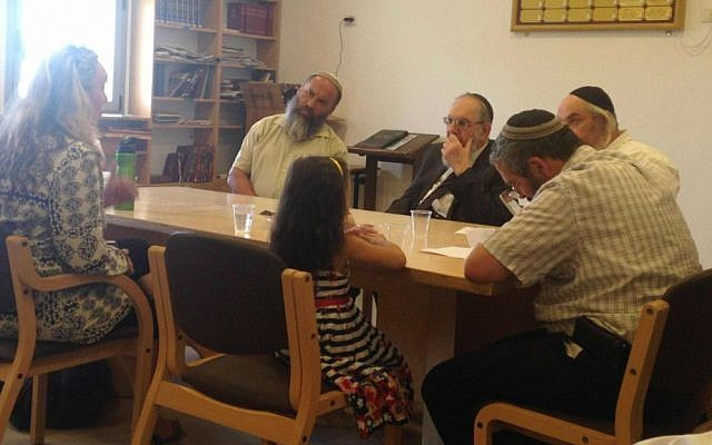 Convert 'Katya' and her daughter sit before the independent Giyur K'halacha conversion court, led by Rabbi Nahum Rabinovitch (center) on August 10, 2015. (courtesy)