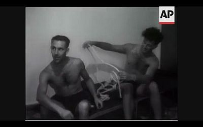 Two British military policemen, following their 1947 kidnapping from a swimming pool in Ramat Gan (Screenshot of newsreel footage from YouTube)