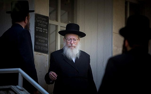 Then-deputy health minister Yaakov Litzman leaves a session of his United Torah Judaism party's Council of Torah Sages in Jerusalem on August 27, 2015. (Yonatan Sindel/Flash90)