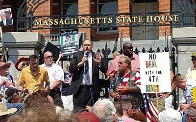 Up to 1,000 people gathered outside the Massachusetts State House in Boston to protest the proposed nuclear deal with Iran on August 30, 2015. Addressing the crowd is WRKO radio host Jeff Kuhner, host  and convener of the rally. (Matt Lebovic/The Times of Israel)