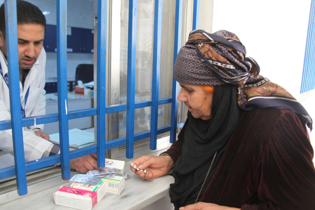 A Palestinian refugee living in Syria receives medication at an UNRWA clinic