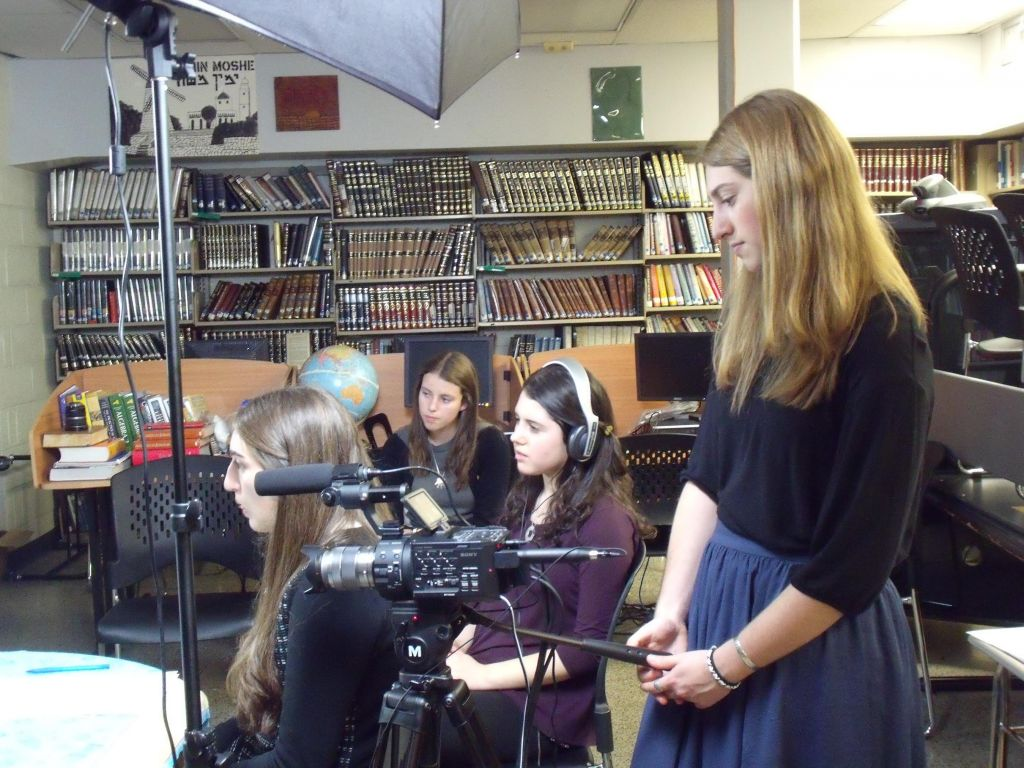 Students from Yeshiva University High School for Girls filming an interview for 'Names, Not Numbers.' (Names, Not Numbers)