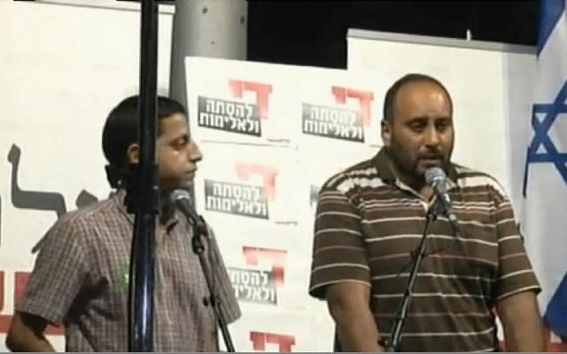 Nasser Dawabsha, uncle of slain baby Ali Dawabsha, speaks at a rally in Tel Aviv on Saturday, August 1 2015. (Screen capture Ynet)