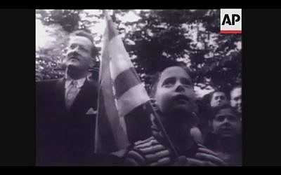 In 1948, people gathered outside the Jewish Agency building in Washington, D.C., to celebrate the birth of the Jewish State (Screenshot of newsreel footage from YouTube)