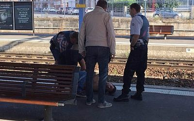 A photo taken by a passenger with a smartphone through the window of a Thalys train shows police detaining a suspect on the platform at the main train station in Arras, northern France, on August 21, 2015 (AFP/CHRISTINA CATHERINE COONS)