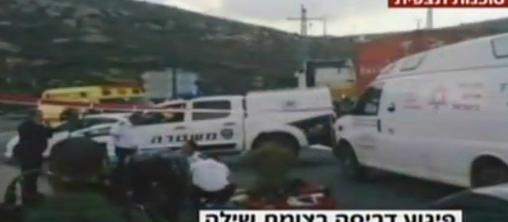 Rescue personnel and security forces attend the scene of a terror attack in the West Bank on Thursday, August 6, 2015. (screen capture: Channel 2)