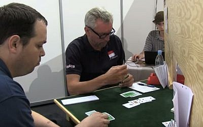 Israeli Bridge player Ron Schwartz, left, at an international tournament in 2014. (screen capture: YouTube)