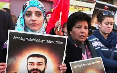 File: Shireen Issawi, left, at a demonstration for Palestinian prisoners. (screen capture: YouTube)