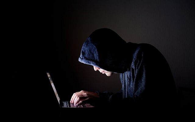 Illustrative hacker image via Shutterstock
